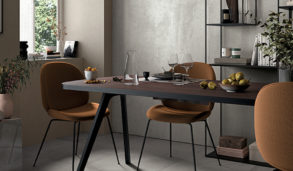 Spisestue med flislagt gulv inspirert av metall
