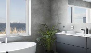 Baderom med store, grå fliser på gulv og vegg.