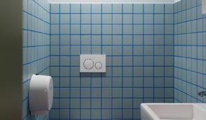 lite toalett med blå fliser og blå fuger