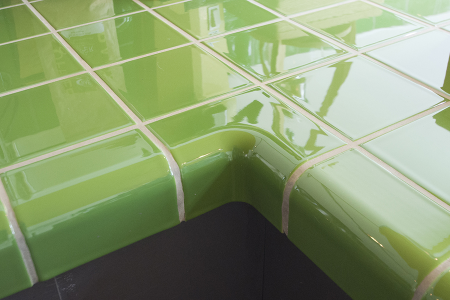 Grønne fliser med avrundede hjørner