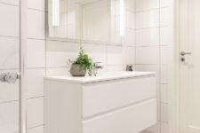 Tidløst bad i Eidsvoll med hvite veggfliser