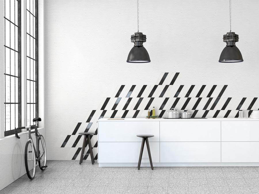 Kjøkken med terrazzoflis på gulv og skråskjærte veggfliser